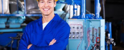 portrait of young technician with arms crossed