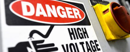 High voltage sign, electrical board close up