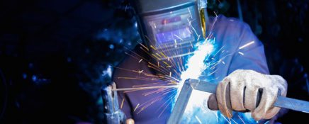 Welder welding structure material with lighting sparks